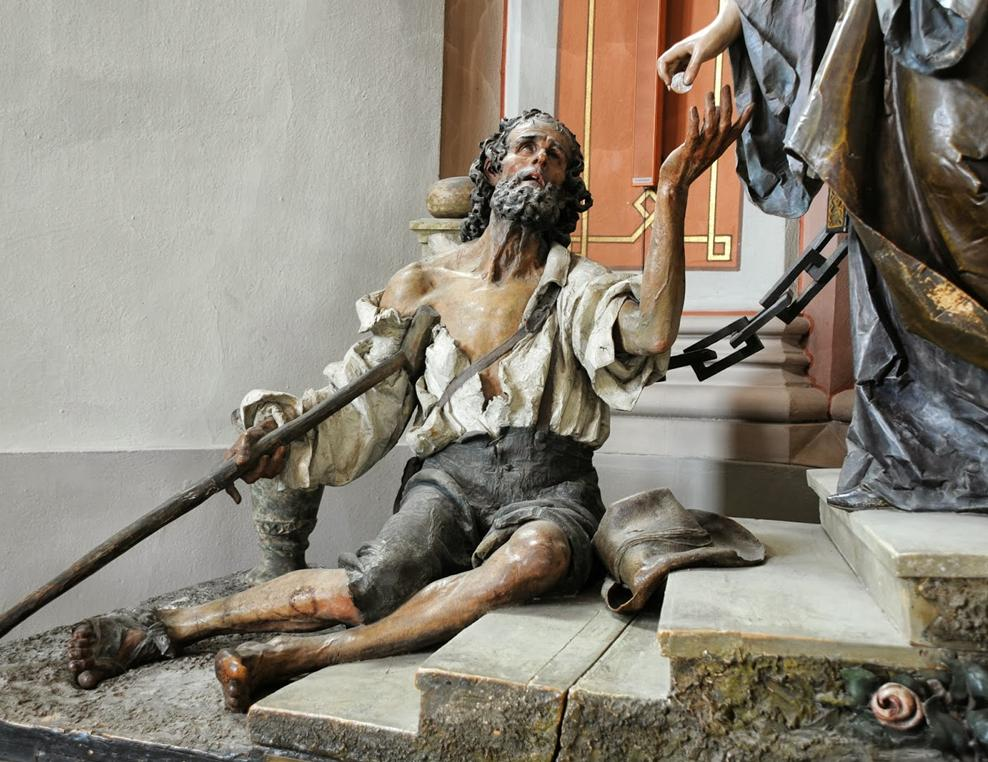 A 20th Century woodcarved statue of a beggar from the group of Saint Elizabeth which was sculpted by Rudolf Moroder (Courtesy The Record)