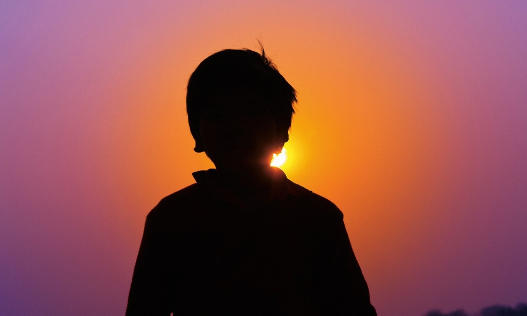 Sunset boy silhouette