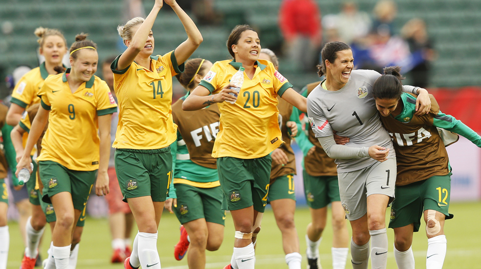 EDMONTON, AB - JUNE 16: Caitlin Foord #9, Alanna Kennedy #14, Samantha Kerr #20, Lydia Williams #1 and Leena Khamis #12 of Australia celebrate after a 1-1 game with Sweden during the FIFA Women's World Cup Canada Group D match between Australia and Sweden at Commonwealth Stadium on June 16, 2015 in Edmonton, Alberta, Canada. (Photo by Todd Korol/Getty Images)